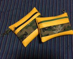 黄色い合皮布と迷彩柄のポーチ